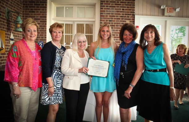 Supervisor Judi Bosworth and Scholarship Recipient, Megan Erickson, hold Erickson¹s town certificate, along with Co-Chairpersons (left to right) Karen Spitz, Donna Ciampe, Sue Neville, and Sue Thompson